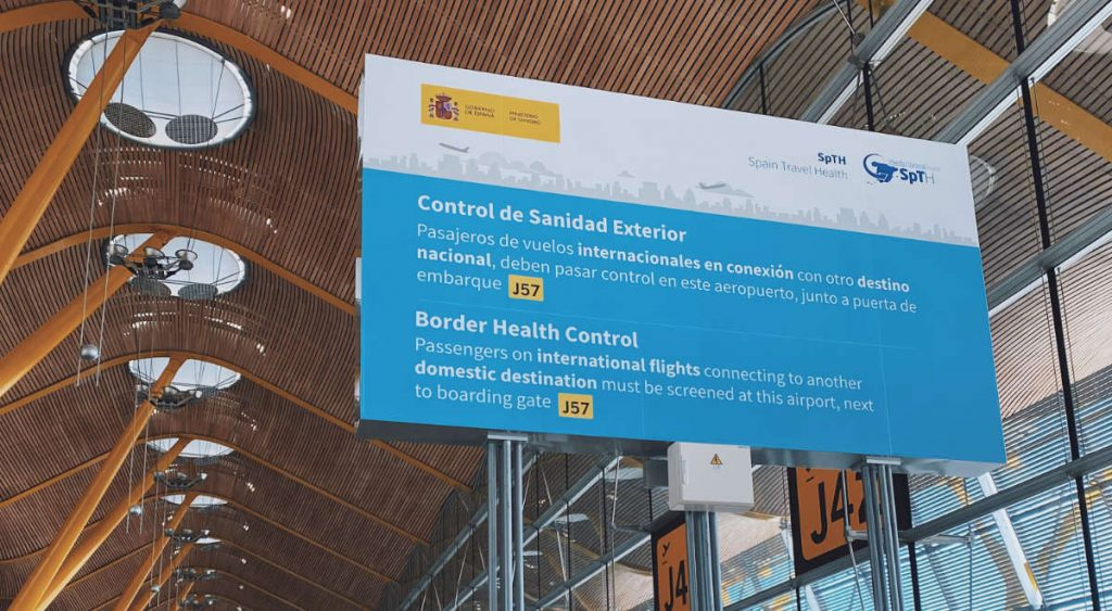 Showing a negative PCR test at the border control at Madrid airport