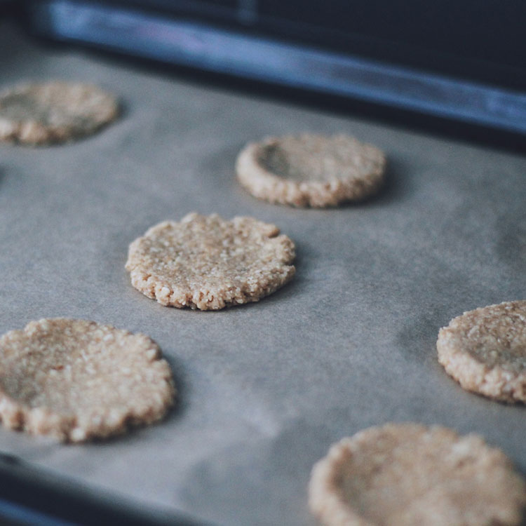 A flattened dough ball for an oat cookie